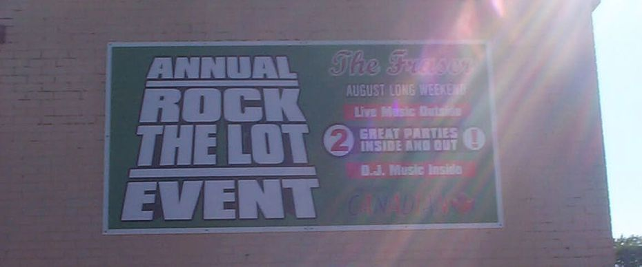 annual rock the lot event sign
