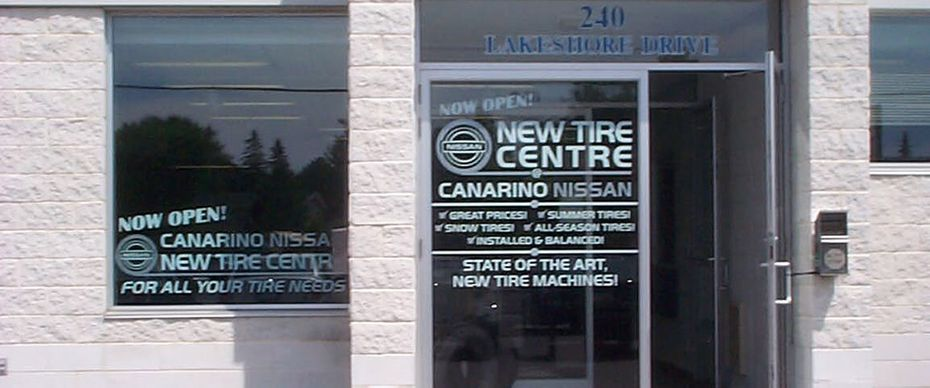 new tire centre building signs